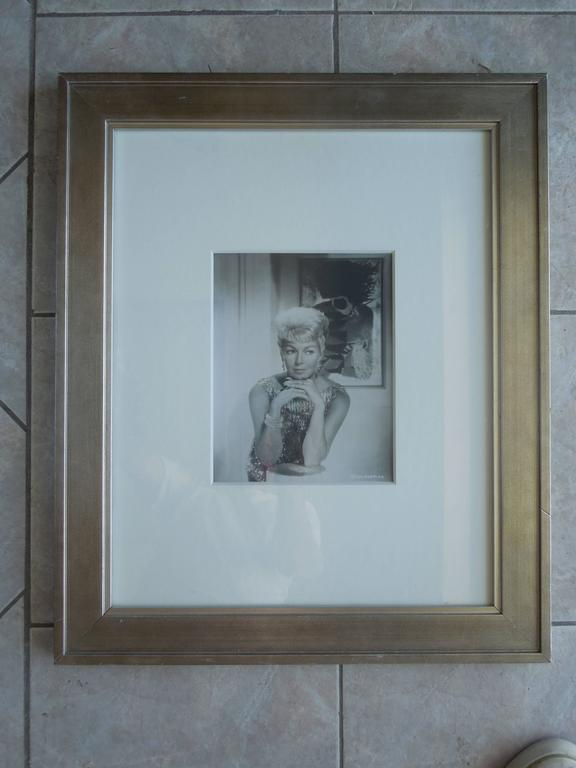 Part of a incredible collection from a Palm Springs designer, is this original photograph of Lana Turner taken for MGM studios in the 1960s. Beautifully framed in antique silver and thick white matt. Studio number on photo. Photo image: 8
