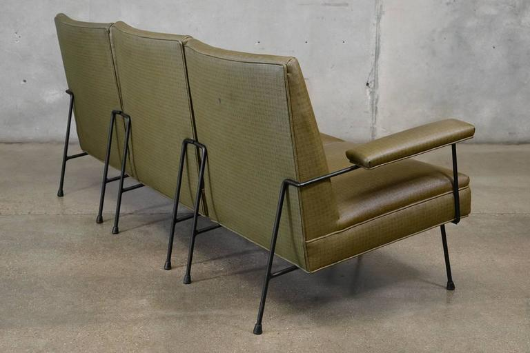 Three-piece modular sofa designed by Milo Baughman for Pacific Iron, 1950s. Since its modular this can be used in a number of configurations. These retain what appears to be the original vinyl, with a circle/square pattern. There is some slight