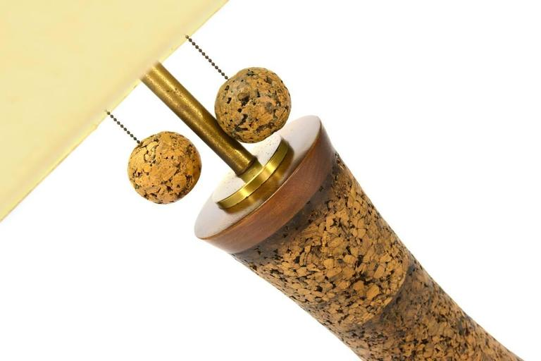 This is an epic cork floor lamp. Measuring a massive 81″ tall with the shade, that is no typo. A statement piece for sure. Dark wood accents cap the top and bottom of the cork body. And large cork ball pulls hang just below the shade to control the