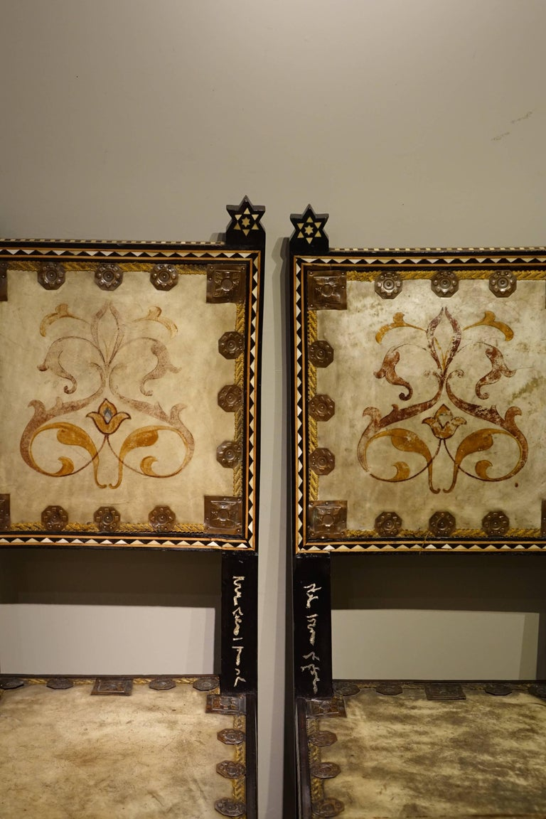 Pair of chairs by Carlo Bugatti Italian designer (1856-1940) Chairs are in ebonized wood, marquetry, hammered copper, painted parchement. Carlo Bugatti was an Italian decorator, designer and manufacturer of Art Nouveau furniture. He was born in