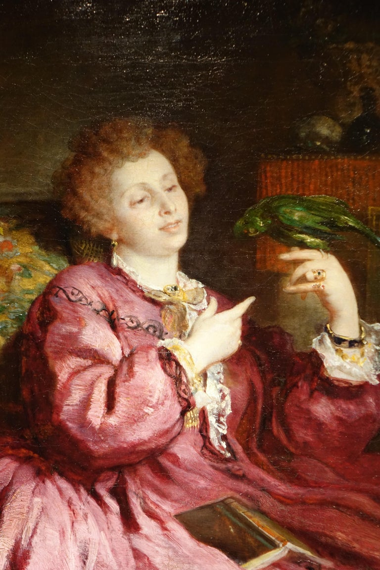 Oil on canvas representing a young woman interrupting her reading to play with her parrot, signed in left as V.de Bornschlegel. Victor de Bornschlegel was a French painter, born in Sierck, Moselle (eastern departement) in 1820. He was specialized