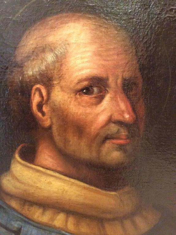 Early 17th century Italian school portrait of a clergyman, Venice. Papal coat of arms upper left. Modern frame.