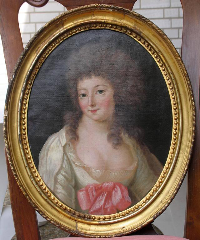 A pair of 18th century portrait paintings of a lady, France. The paintings may have been part of a set of four representing the Four Seasons. The painting showing the lady wearing a fur hat and scarf would be the representation of winter, whereas