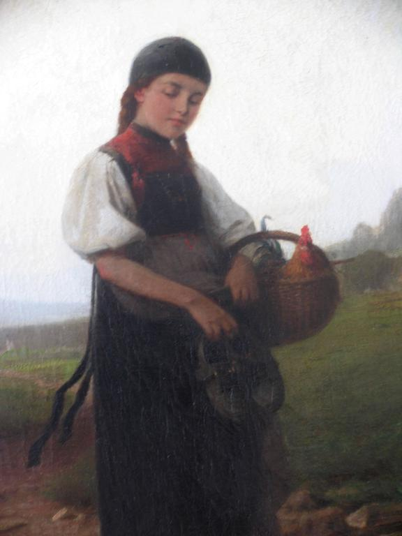 A girl wearing a traditional German costume is carrying a rooster in a basket.