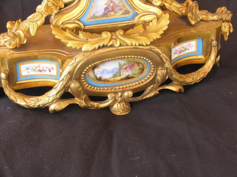 Unique French 19th century mantel clock. This exquisite mantel clock has a Sevres porcelain dial plate and other Sevres porcelain decorations.   The movement with spring suspension. Striking every half hour on a bell.  The shipping from Germany to