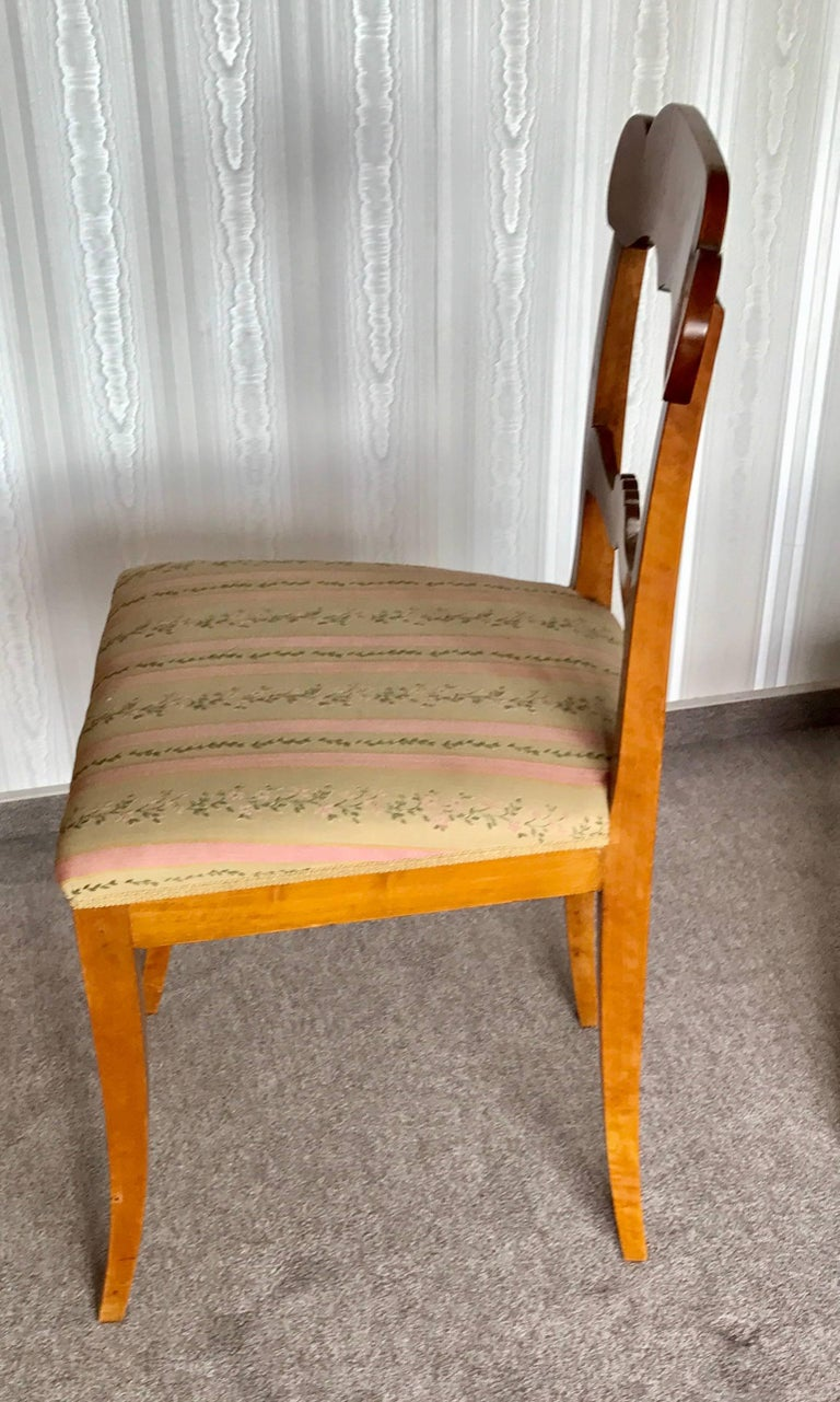 A set of six Gustavian chairs, Sweden, 1830, birch veneer.  The chairs are in good original condition. The chairs will be shipped from Germany. The shipping costs to Boston are included.