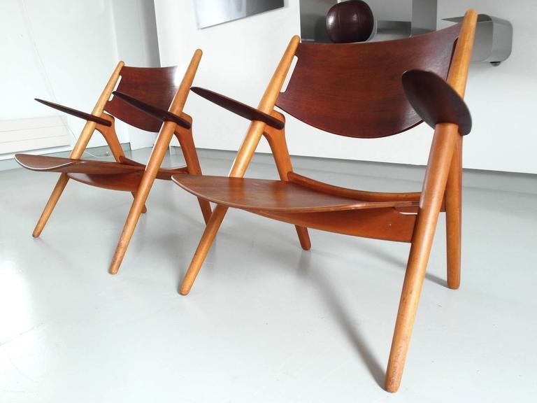 Carl Hansen Chairs hans wegner pair of early ch-28 sawbuck chairs for carl hansen