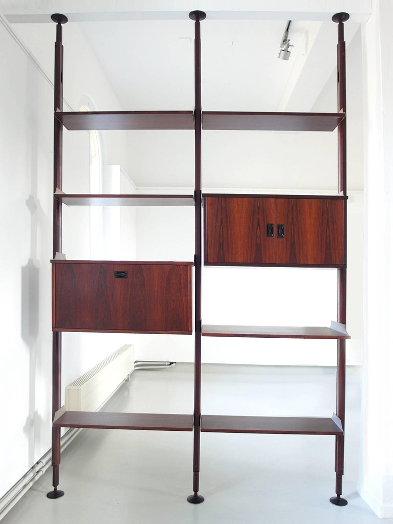 A beautiful shelving system by Stildomus, Italy, circa 1960. The library is composed of five small shelves, a large bookshelf and two cabinets, all made of luxury Caviuna hardwood. The shelves and cabinets can be composed easily according to your
