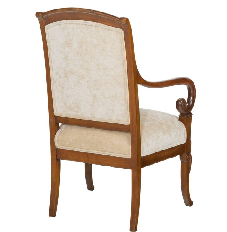 19th century French Charles X mahogany armchair, circa 1825. The perfect armchair coming right after the Louis XV, Louis XVI periods in Franch with elegance and charm. Contemporary upholstery with no appearance stains or issues.  Height: 36.75