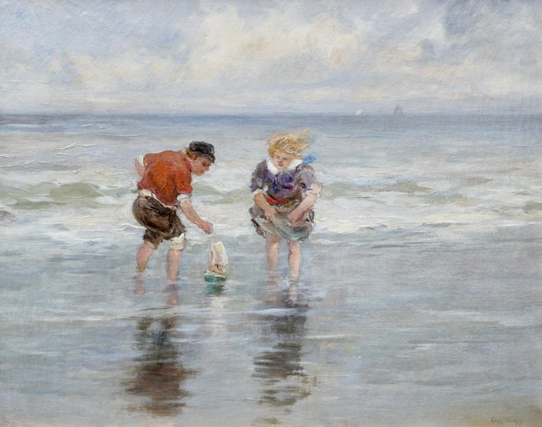 Charles Paul Gruppe (American, 1860-1940). A delightful and cheerful 19th century scene of a young boy and girl playing with a toy sailboat in a tidal pool at the beeck with ocean wave braking behind them. Faint sailboats on the horizon with sun