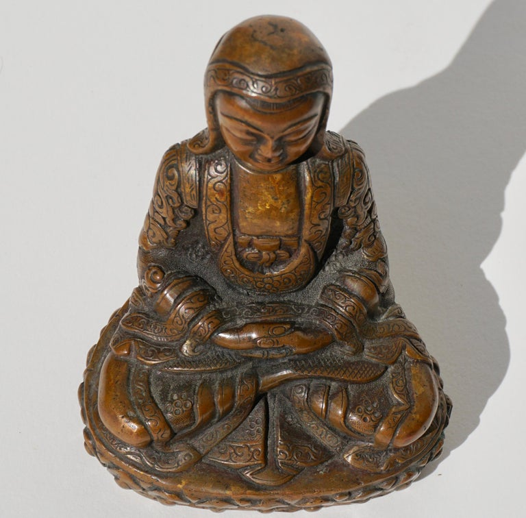Cast 15th-16th Century Tibetan Copper Alloy Bronze Lama Buddha with Silver Inlay For Sale
