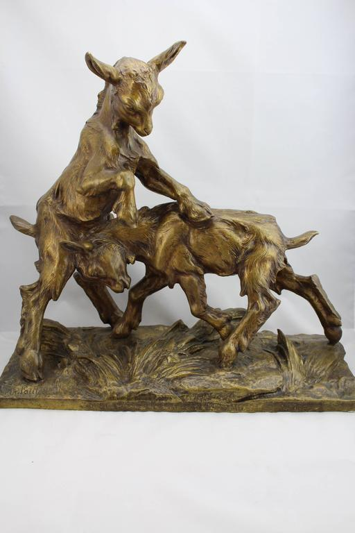 A large Charles Paillet French (1871-1937) bronze of two playful goats