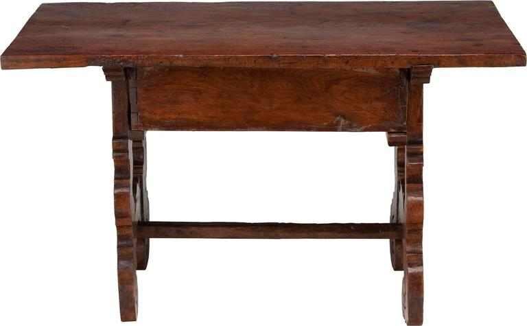 There is no mistaking the style and sophisticated design of this exquisite antique Spanish side table from the last quarter of the 17th century or early 18th century.  This stunning table with one drawer will definitely become a key piece in your
