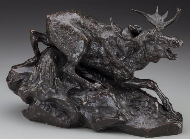 Antoine-Louis Barye (French, 1796-1875).  Élan surprised par un Lynx, circa 1876. Bronze with brown patina  14 inches (35.5 cm) long, 9 inches (22.9 cm) high. Inscribed on base with Barbedienne foundry mark: Barye / F. Barbedienne