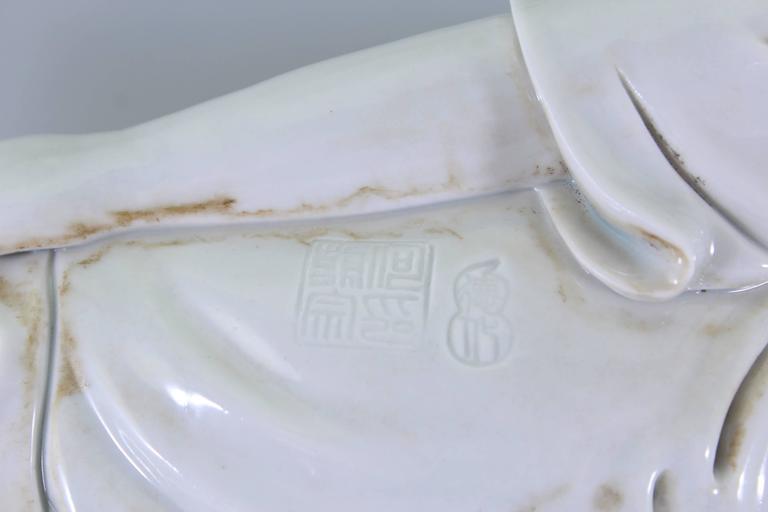 Porcelain 'Dehua' He Chaozong Figure of Resting Buddha, Qing Dynasty, 19th Century