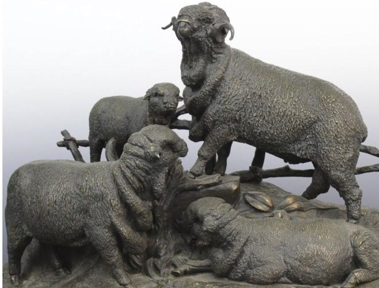 Antique figural grouping of a Ram or Sheep family by Jules Moigniez. Cast bronze construction with very nice detailing and dark patina. Signed on the front. Measures 16