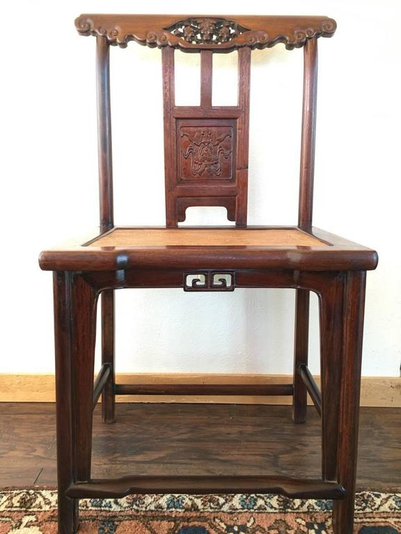 Beautiful pair of Chinese hardwood side chairs. Very light and beautiful grain, possible Huanghuali, 19th century.