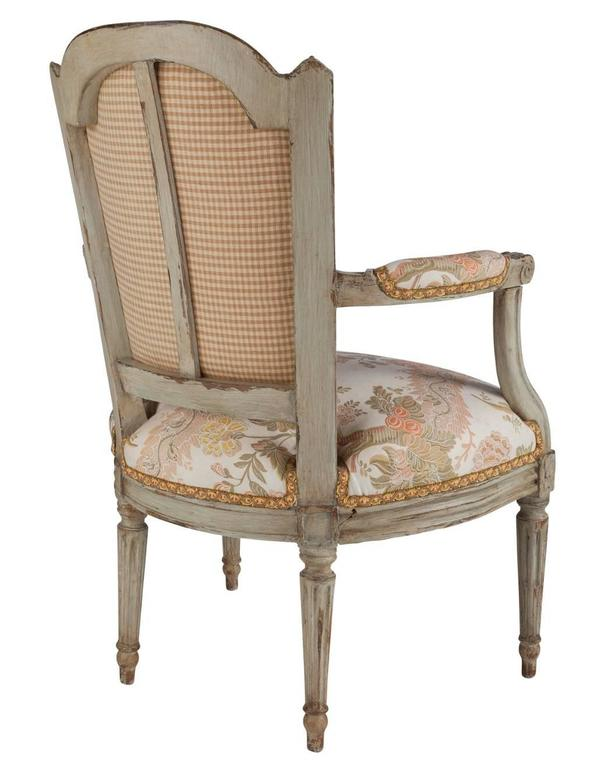 A French Louis XVI painted wood and upholstered fauteuil, late 18th century.  Good condition.