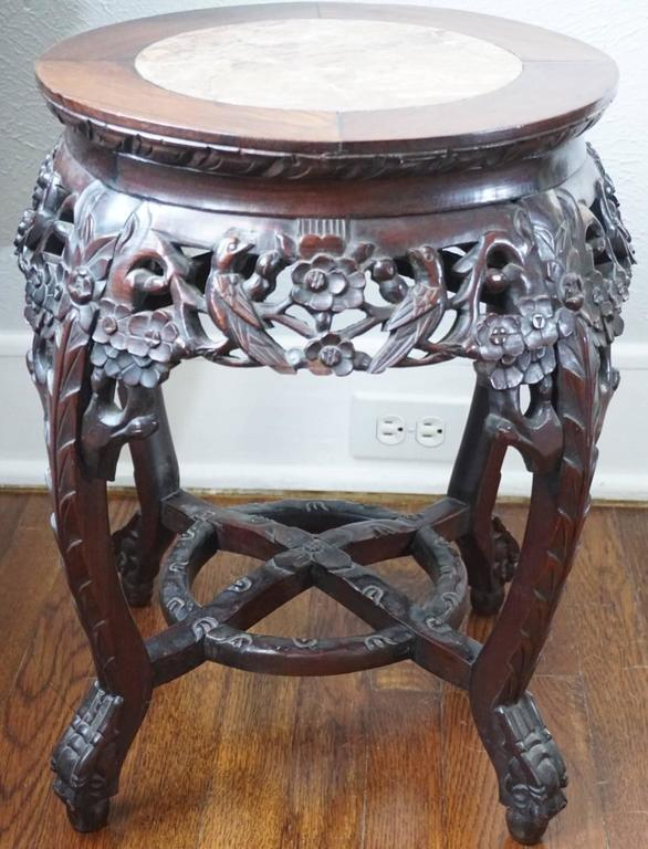19th century Chinese rosewood and marble carved stand with motifs of birds, flowers and branches.  Measures: Height 20.5 inches, width 18 inches.