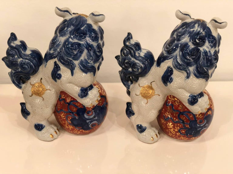 Chinoiserie Pair of Blue and White Foo Dogs  For Sale