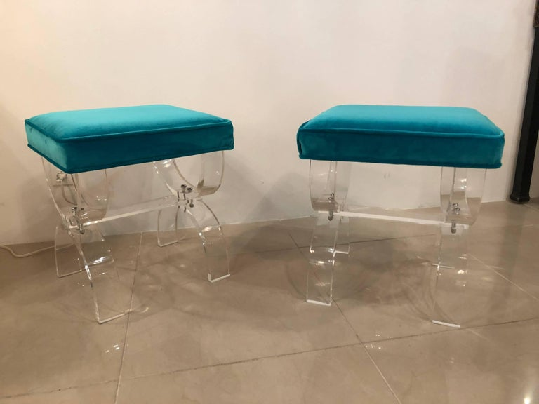 Professionally polished Lucite pair of X-benches stools with new blue velvet upholstery. Meticulously restored.