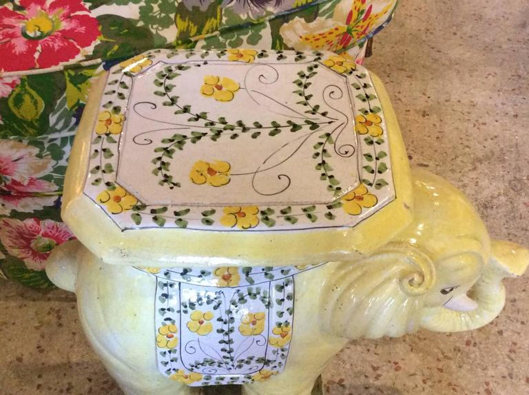The cutest vintage Hollywood Palm Beach Regency Italian yellow floral terracotta elephant stand. Extremely rare in this yellow color with sweet flowers. Very heavy! Made in Italy.   Can be used as a side end table.