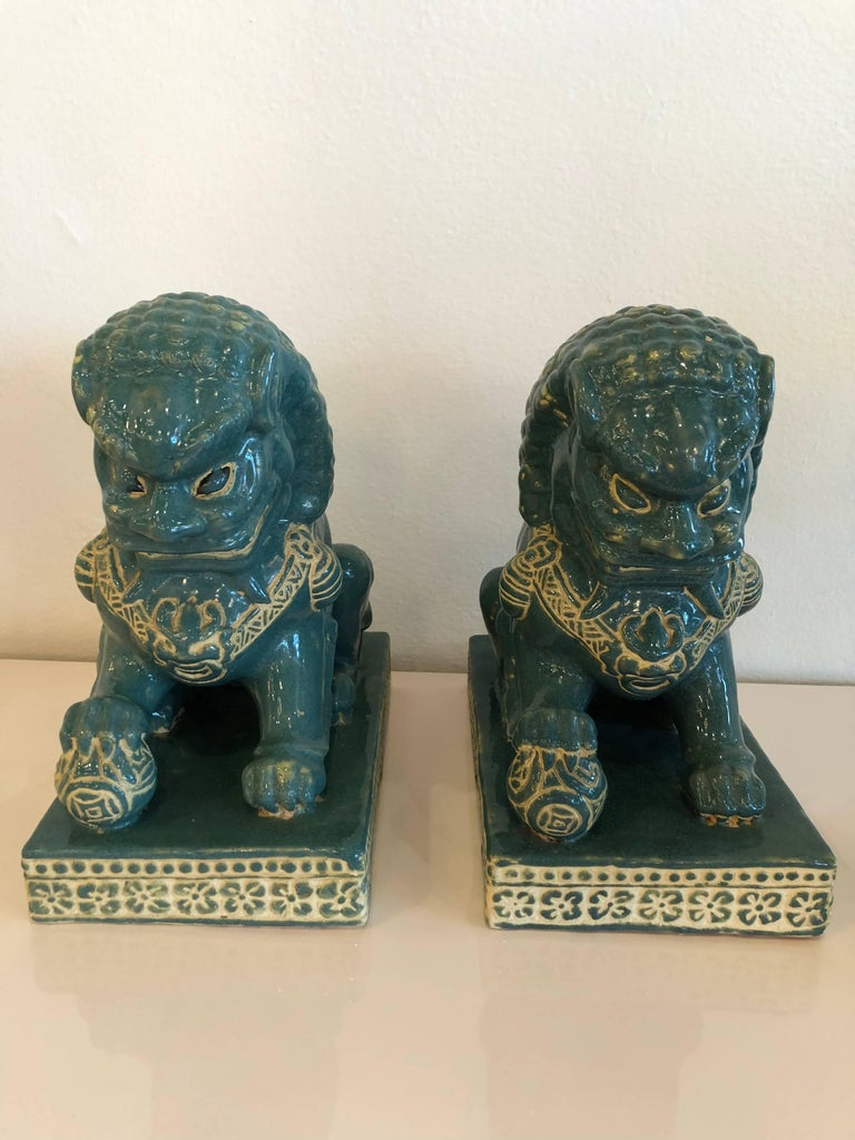 Lovely pair of  vintage teal green blue foo dogs. No chips or breaks.