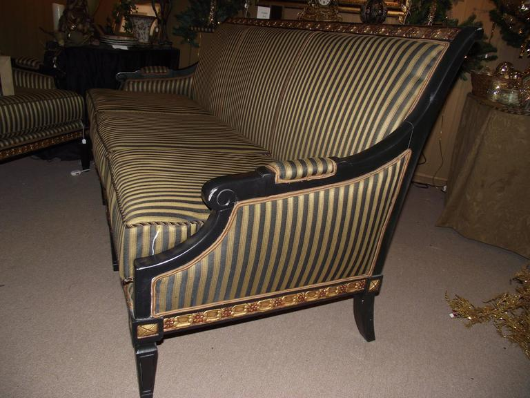 neoclassic style sofa covered in black and gold stripe at