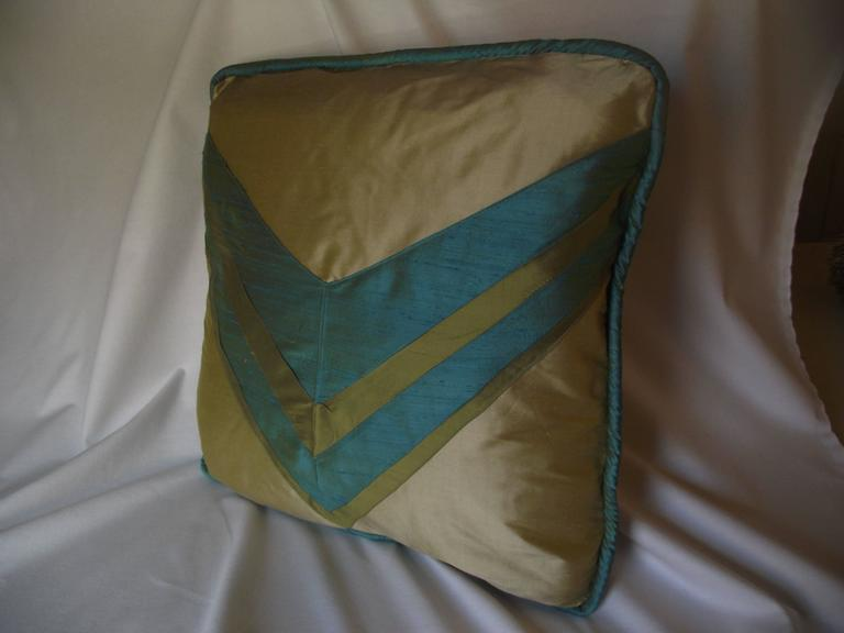 Original deco designed throw pillow by Gantt Design Studio. It is made of three colors of silk and comes on a non allergic polyester pillow bat insert.