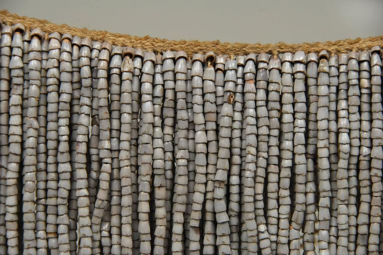 """Offered by Callie Morgan Oakes. 20th century tribal modesty skirt cache sexe. Gnau culture, West Sepik, Papua New Guinea.  The understated elegance of these tribal """"petticoats"""" have a subtle beauty – textural with a quiet movement. Made from"""