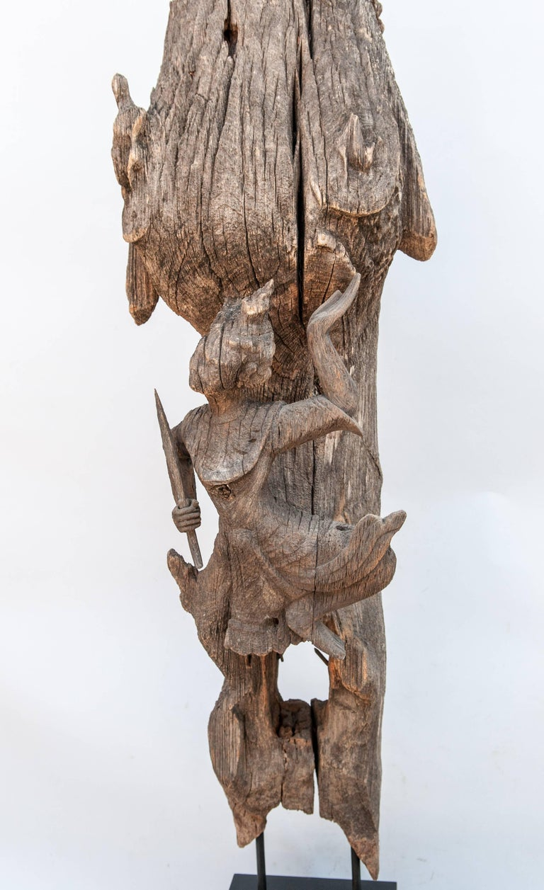 Chofa Roof finial from Burma. Carved and eroded teak wood. Early 20th century. Mounted on a tiered stand. This beautifully eroded Chofa comes from a temple or aristocratic residence in Burma. The Chofa- literally, sky tassel - is a stylized