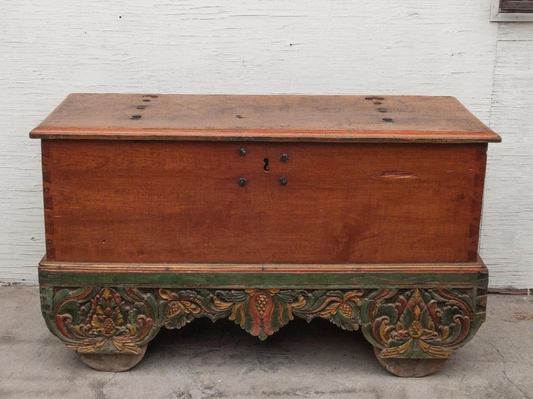 Mid-20th century teak chest on wheels from Java. Original color and hardware. Measures: 56