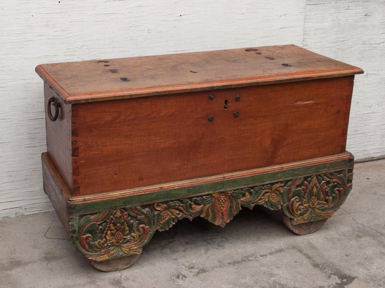 Rustic Mid-20th Century Teak Chest on Wheels from Java. Original Color and Hardware. For Sale