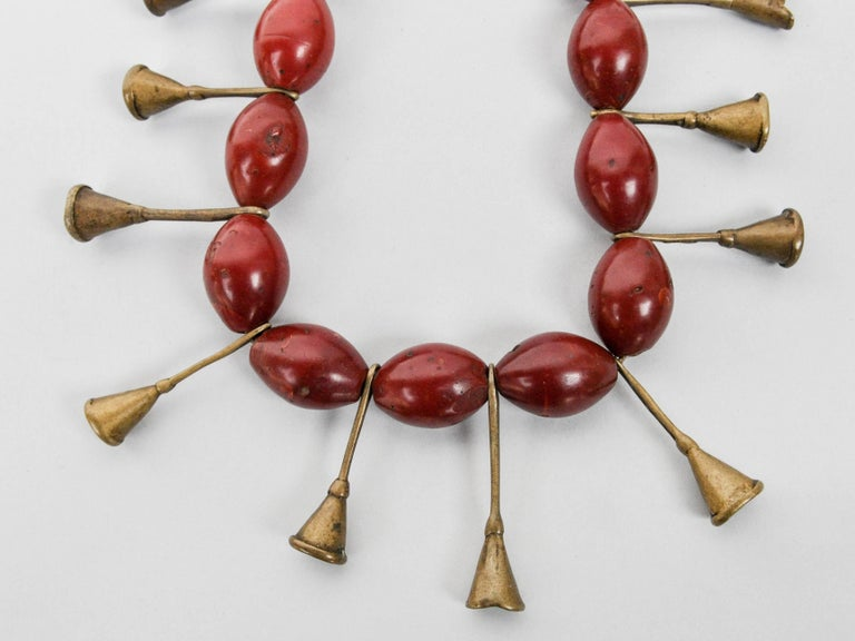 Ao Naga tribal glass and brass trumpet bead necklace early to mid-20th century Offered by Bruce Hughes. Tribal glass bead and brass trumpet bead necklace from the Ao Naga Tribe of Burma, early to mid-20th century. The piece comprises 17 oblong glass