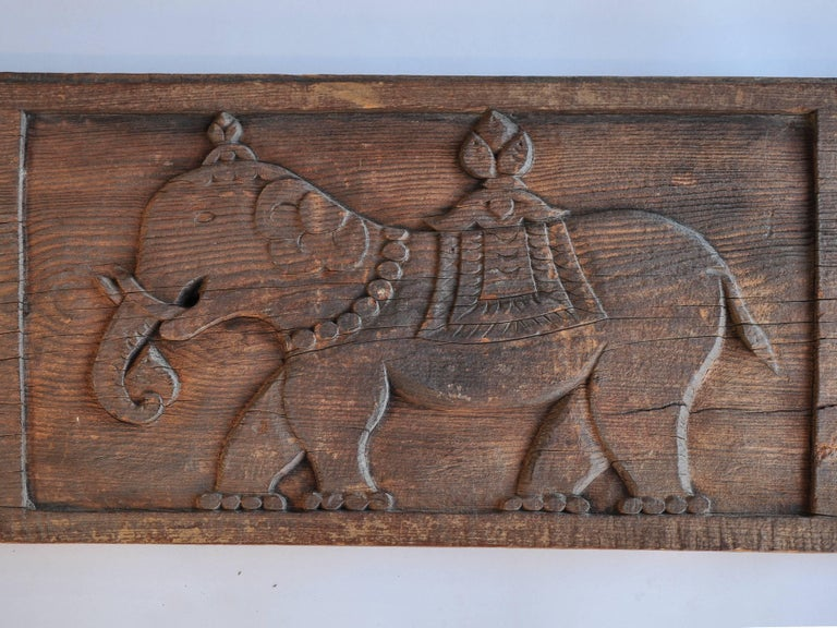 Carved Tibet architectural panel elephant and bird motifs early to mid-20th century. Offered by Bruce Hughes. This charming panel, carved from a plank of pine wood, would have adorned a Tibetan home or temple. Elephants, of course, are widely loved