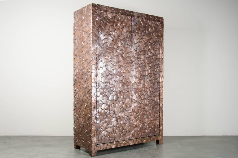 Isola Design Armoire Antique copper Hand repoussé Elmwood Limited edition  Repousse´ is the traditional art of hand-hammering decorative relief onto sheet metal. The technique originated around 800 BC between Asia and Europe and in Chinese