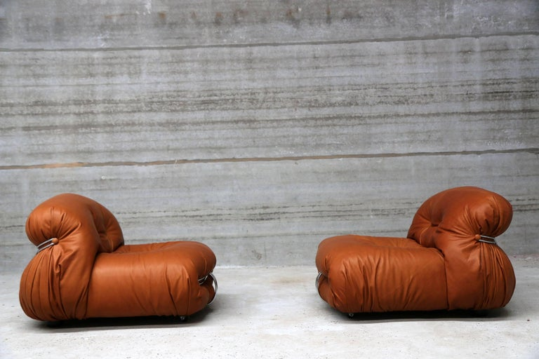 Two re-upholstered lounge chairs designed by Afra & Tobia Scarpa for Cassina. Rich full grain cognac leather. Matching two-seat also available.