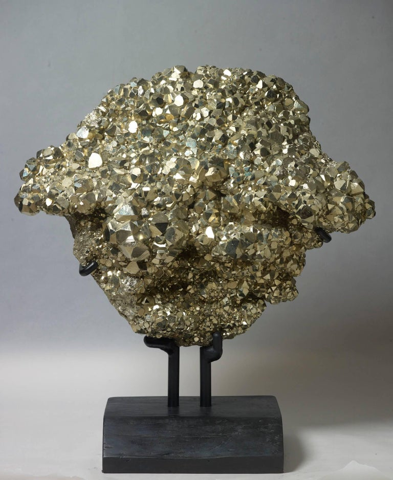 Unusually large and impressive plate of dodecahedral pyrite from Peru. Measures: 67 x 59 x 29 with stand.
