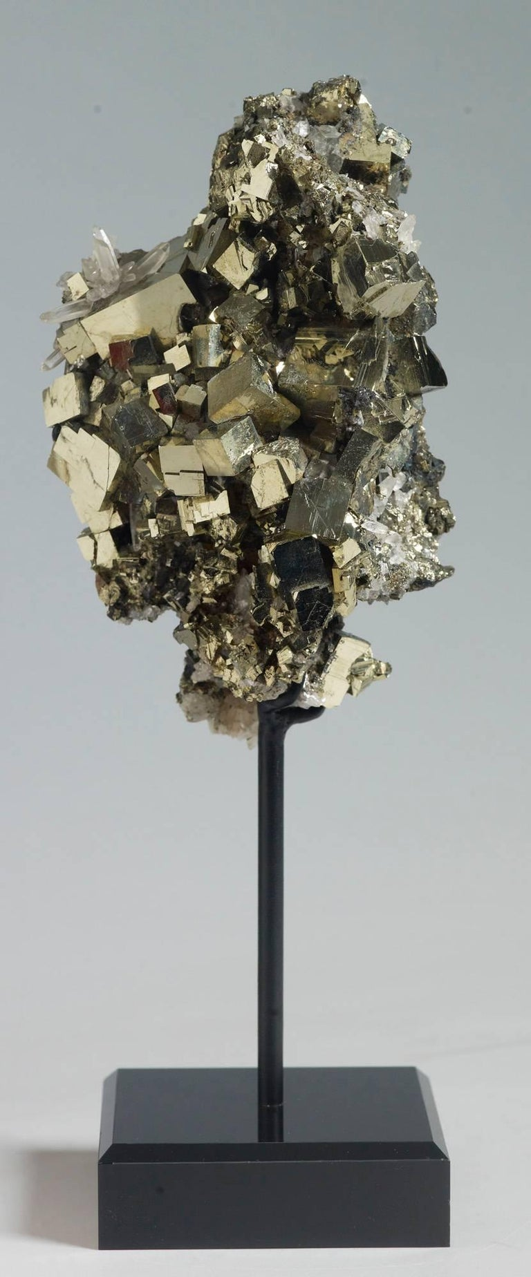 Cubic pyrite with embedded quartz crystals. Measures: 27 x 9 x 8 with stand.