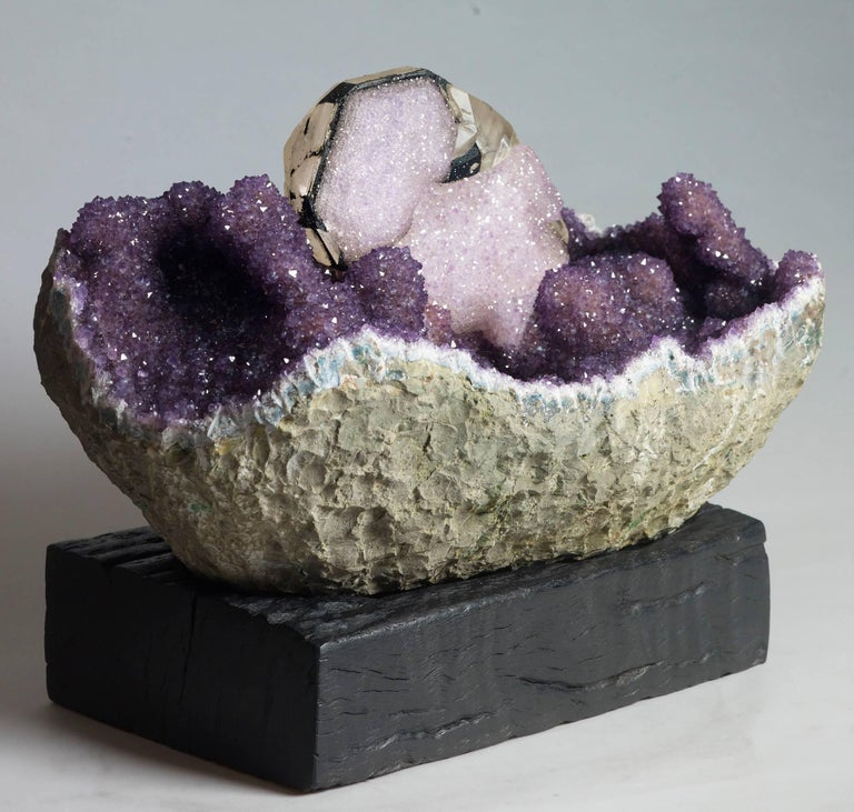 """A beautiful specimen of amethyst and calcite reminiscent of an amethyst """"boat"""" with calcite """"sail"""". This is quite unique and displays beautifully from both sides. Measures: 31 x 42 x 24 with stand."""