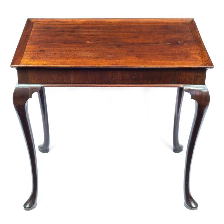 A good mid-18th century George II period mahogany tray-top table  English, circa 1750.  The solid single-piece mahoganyrectangular tray top, havingan applied convex molding with a beaded outside edge, abovea plain veneered apron with a convex