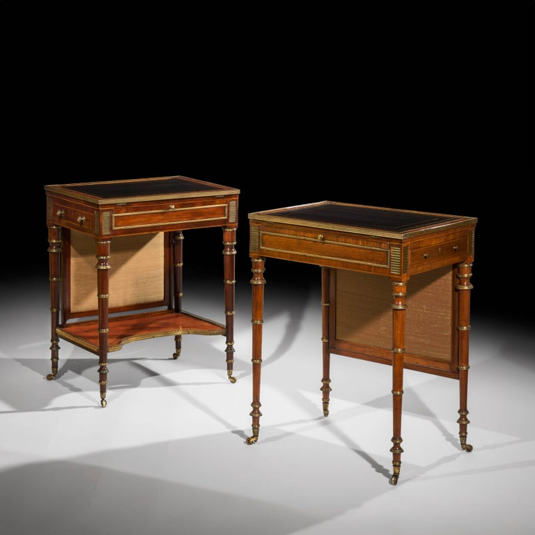 An extremely fine, rare and important matched pair of late George III - early Regency period ormolu and brass mounted small writing tables, firmly attributed to John McLean,  Circa 1800 and 1810.  One in mahogany, the other one in rosewood, inlaid