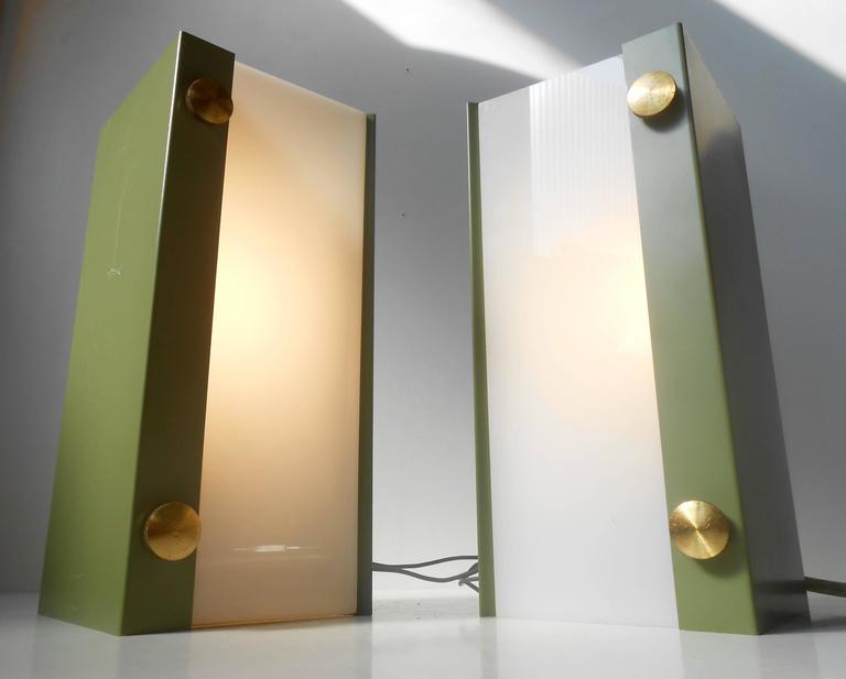Simplistically designed wall lamps with light green powder coated aluminium exterior, large brass screws and fluorescent acrylic shades. Anonymous Scandinavian maker/design, circa 1960-1970. Measurements: W/H/L: 9,25 inches (24 cm), W/H/L: 6 inches
