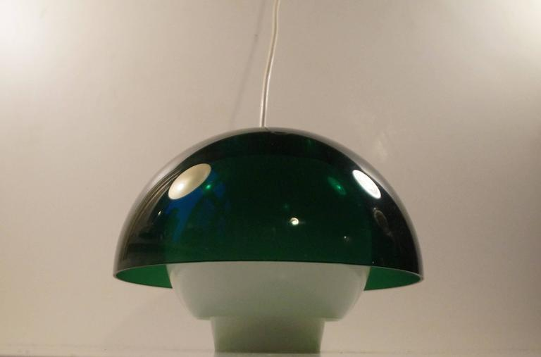 Rare plexiglass pendant lamp designed by Bent Karlby and manufactured by ASK Belysninger, Denmark in the 1970s. Splendid condition. Measurements: D: 10 inches (25 cm), H: 6,8 inches (17 cm).