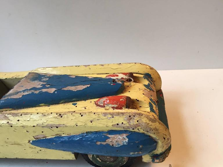 Mid-20th Century Unique, Decorative & Rustic 1930s Streamlined Wooden Toy Car with Dunlop Tires For Sale