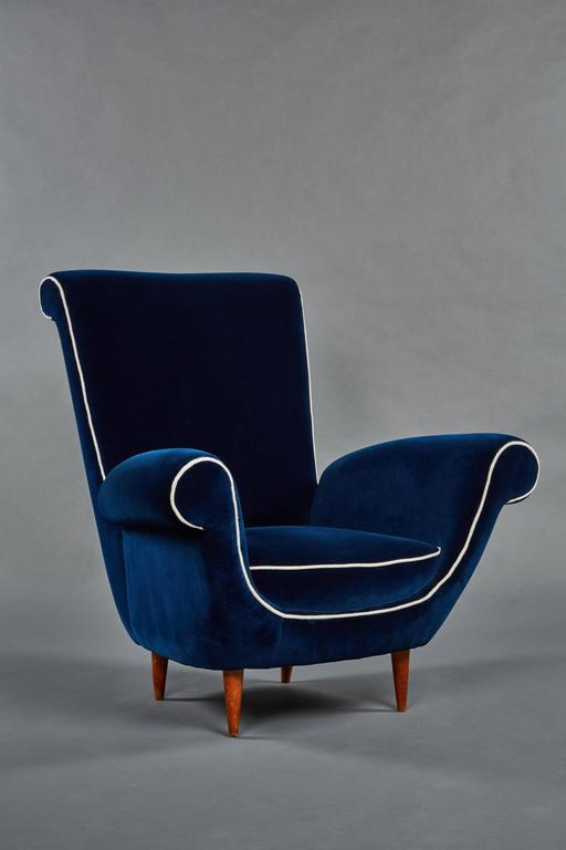 A Pair Of Ico Parisi Attributed Blue Velvet Armchairs. Scrolled Details Are  Sharply Accentuated By