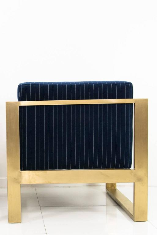 Modshop's Kube chair. Finished in navy pinstriped velvet and a brass U-leg frame.  Measures: 31.5