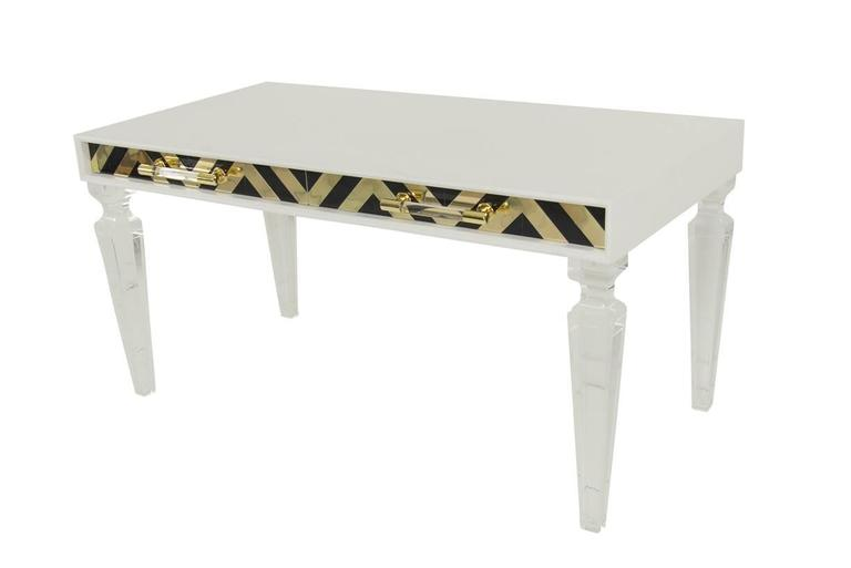Modshop Capri desk has gone glam. Not only does the Capri collection represent the best of the current Chevron trend inset in the beautifully crafted door fronts, but this one features our Lucite and brass bar pulls and our Palm Beach Lucite legs.