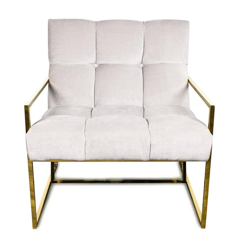 A slick brass frame, a slight pitched back and tufted velvet is perfect on it's own, or pair it up. Shown in cream velvet.   Dimensions:  31