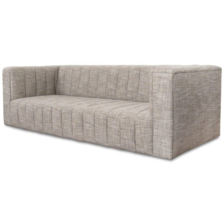 Introducing the Monaco Sofa. The front of the sofa features top to floor channel tufting creating striking vertical lines on a chubby modern frame. Customizable plush linen highlights this sleek look. The symmetry of the design of the Monaco Sofa